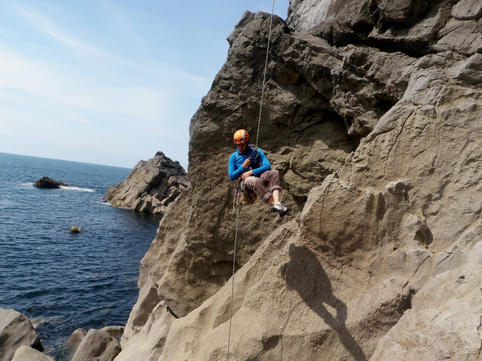Abseiling into a sea cliff